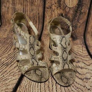 Strappy  snake skin heels